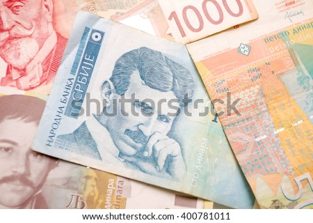 Nikola Tesla 100 dinar bill in the pile of Serbian dinars bills - stock photo
