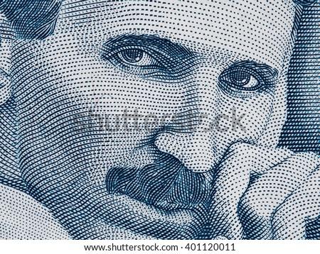 Nikola Tesla portrait on Serbia 100 dinars banknote extreme macro, Serbian money closeup - stock photo