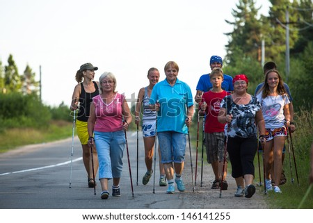 NIKOLSKY, RUSSIA - JULY 14: Unidentified participants during of local competitions in Nordic walking devoted to the Day of Health on July 14, 2013 on Nikolsky, Russia.