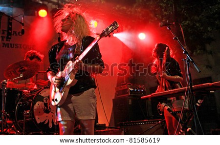 """NIMES, FRANCE - JUNE 21 : Group """"HYPHEN HYPHEN"""" in concert on June 21, 2011 in Nimes, France - stock photo"""