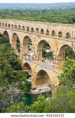 NIMES, FRANCE - MAY 04, 2015: Pont du Gard, over the Gardon river, is roman aqueduct built to provide water to the city of Nimes from the river Eure in the first century A.D.