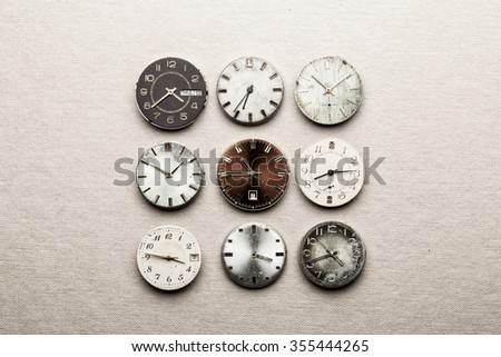 Nine clock dials showing different time - stock photo