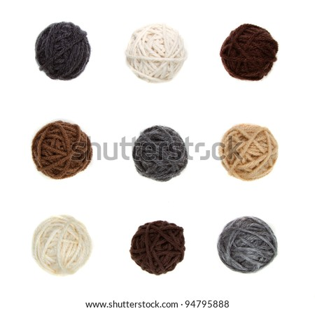 Nine different balls of yarn in neutral colors isolated on a white background - stock photo