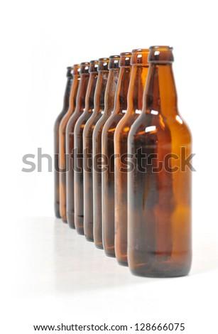 nine empty bottles of beer - stock photo