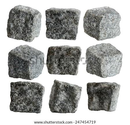 Nine granite pavement cubes isolated with path on white background - stock photo