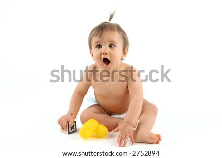 nine month old baby girl surprised as she plays - stock photo