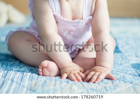 Nine months old baby hands and feet closeup - stock photo