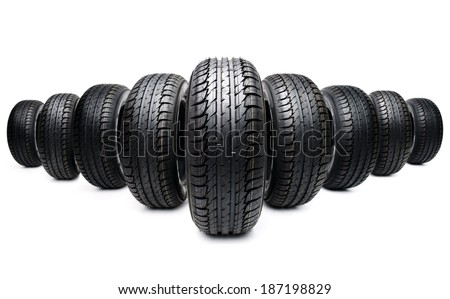 nine new tires formation isolated on white photo - stock photo