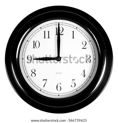 Nine o'clock on the black wall clock, isolated on white background - stock photo