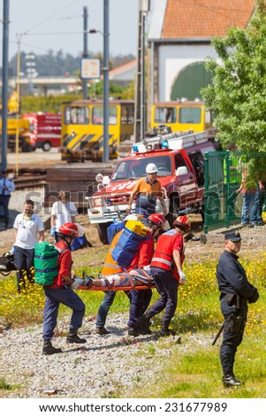 NINE, PORTUGAL - APRIL 12, 2014: Emergency workers at a scene of a train accident simulation in Nine train station - stock photo
