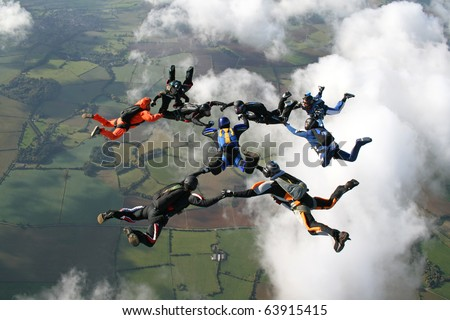 Nine skydivers in freefall - stock photo