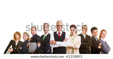 Nine successful business people looking into the camera - stock photo