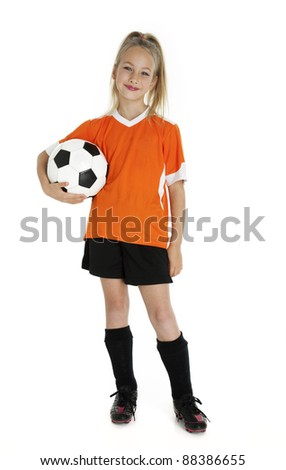 Nine year old girl holding soccer ball isolated on white. - stock photo