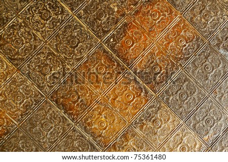 Nineteenth century embossed tin ceiling tiles - stock photo