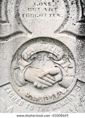 Nineteenth century gravestone clasped hands and epitaphs - stock photo