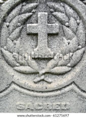 Nineteenth century gravestone detail cross and wreath - stock photo
