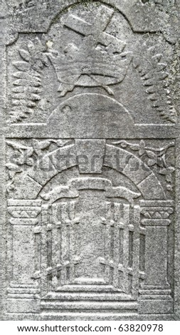 Nineteenth century gravestone detail cross in crown and gates of heaven - stock photo