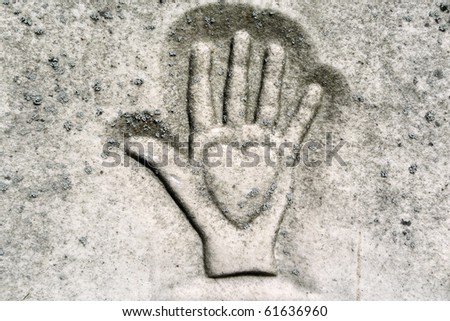 Nineteenth century gravestone detail hand holding heart - stock photo