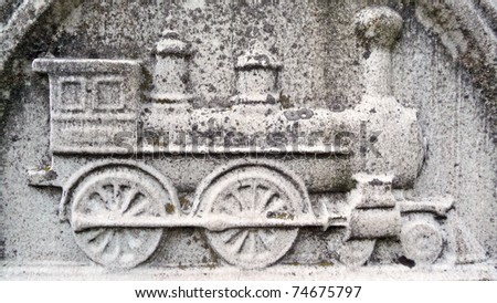 Nineteenth century gravestone detail vintage locomotive bas-relief - stock photo
