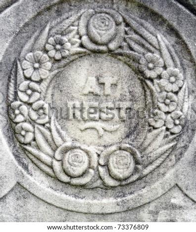 Nineteenth century gravestone detail wreath and epitaph - stock photo