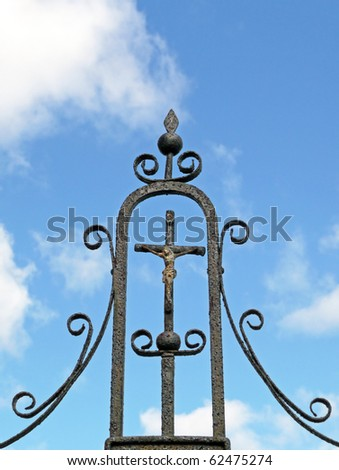 Nineteenth century ornate metal Catholic grave marker - stock photo
