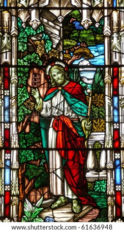 Nineteenth century stained glass church window depicting Jesus Christ with staff - stock photo