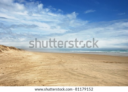Ninety Mile Beach - official New Zealand highway - stock photo