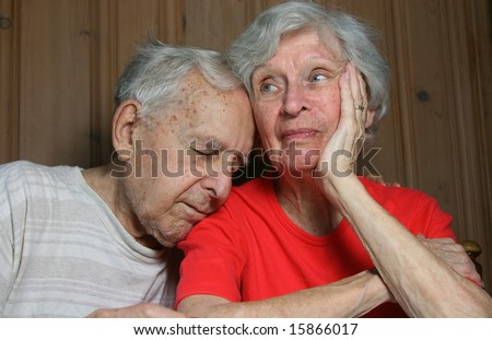 ninety year old couple looking extremely bored - stock photo