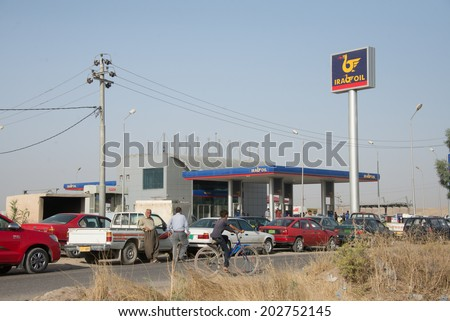 NINEVEH PROVINCE, IRAQ - JUNE 21: Cars wait in line for fuel due to rationing imposed by the Kurdish government in Nineveh Province, northern Iraq, June 21, 2014.