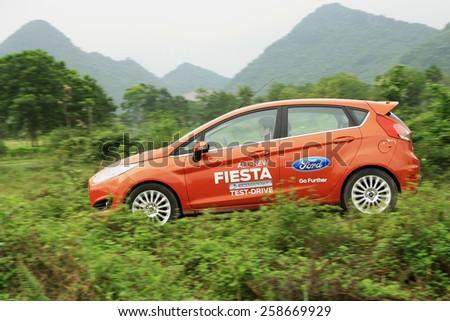 Ninh Binh, Viet Nam - April 16, 2014: Ford Fiesta EcoBoost car runing on the road in Vietnam - stock photo