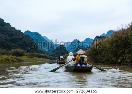 NINH BINH, VIETNAM- MARCH 01,2015: Unidentified tourists in Trang An. Trang An is the scenic area, ranked special of Vietnam.