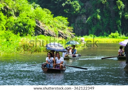 NINHBINH, VIETNAM - MAY 9, 2012: Boats for travel in Tamcoc eco tourism, Ninh Binh, Vietnam.