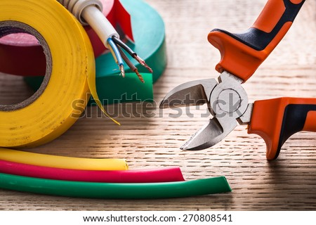 nippers electric cable rolls of isulating tape heat shrinkable tube  - stock photo
