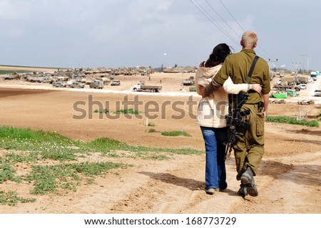 NIR AM, ISR - JAN 17:Israeli soldier hugs his spouse on Jan 17 2009.One of the hardest aspects of being a military spouse is the fact that your spouse could die at any moment. - stock photo