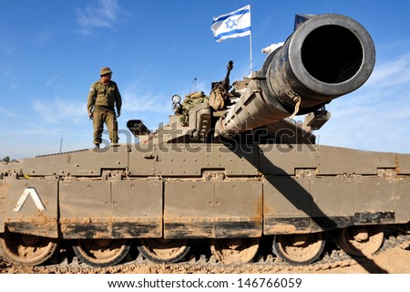 NIR OZ,ISR - JAN 13:Merkava Tank on JAN 13 2009.The Mark IV has the Israeli-designed TSAWS system, It designed to endure the harsh basalt rock conditions of Golan Heights with minimal track-shedding - stock photo