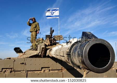 NIR OZ, ISRAEL - JAN 13: Merkava Tank on JAN 13 2009. The Mark IV has the Israeli-designed TSAWS system, It designed to endure the harsh basalt rock conditions of Golan Heights with minimal track-shedding - stock photo