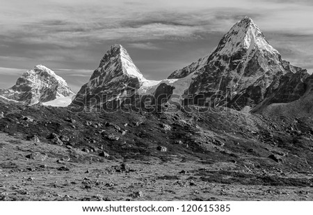 Nirekha (6169 m), Kangchung (6062 m), and Chola (6069 m) in the area of Cho Oyu - Gokyo region, Nepal, Himalayas (black and white) - stock photo