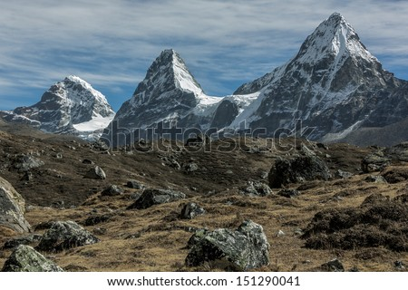Nirekha (6169 m), Kangchung (6062 m), and Chola (6069 m) in the area of Cho Oyu - Gokyo region, Nepal - stock photo