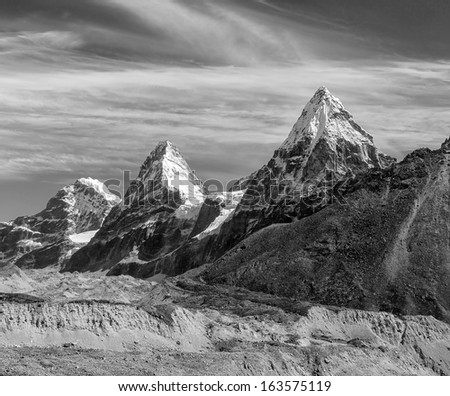 Nirekha (6169 m), Kangchung (6062 m), and Chola (6069 m) in the area of Cho Oyu - Gokyo region, Nepal, Himalayas (black and white) - stock photo