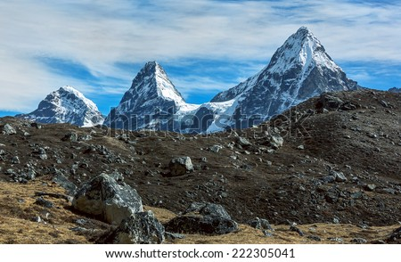 Nirekha (6169 m), Kangchung (6062 m), and Chola (6069 m) in the area of Cho Oyu - Gokyo region, Nepal - stock photo