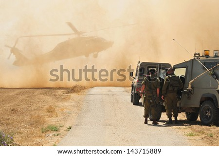 NIRIM, ISR - JUNE 11:Israeli Sikorsky UH-60 Black Hawk helicopter in North Gaza strip on June 11 2008.More than 2,300 aircraft's in 25 nations fly's at the most extreme conditions found on earth. - stock photo