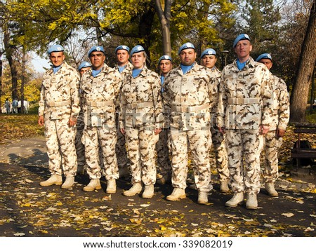 Nis, Serbia - November 14, 2015: Celebration of the Army of Serbia in Nis, images of soldiers for peacekeeping missions, citizens.