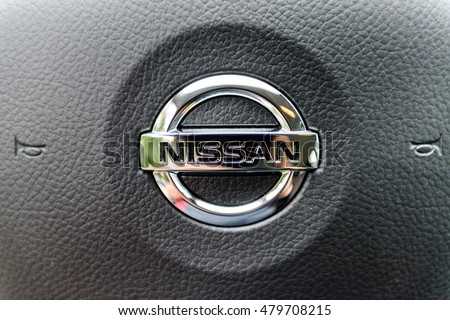 NISSAN Logo. NIZHNIY NOVGOROD, RUSSIA - SEPTEMBER 07, 2016: Parked the car near the city open by owner and specially prepared for taking pictures.