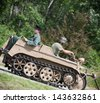 NITRA, SLOVAK REPUBLIC - JUNE 15: Reconstruction of the Second World War operations between Red army and German army, german soldiers go on tracked vehicle on June 15, 2013 in Nitra, Slovak Republic - stock photo