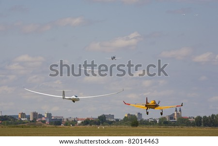 NITRA, SLOVAKIA - JULY 18: Three gliders towed into the air before the first start of the FAI European Gliding Championship on July 18, 2011 in Nitra, Slovakia.