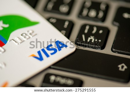 NITRA, SLOVAKIA - MAY 4, 2015: Visa bank credit card laying on laptop keyboard