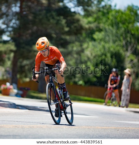 Niwot, CO, USA - June 26, 2016: A cyclist rounds a corner during the Niwot Circuit Race.