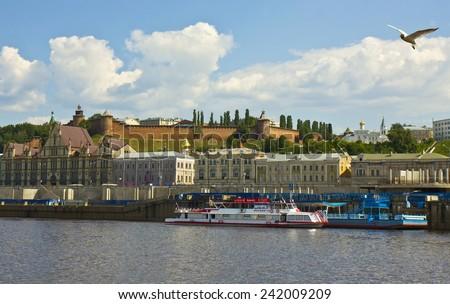 NIZHNIY NOVGOROD, RUSSIA - JUNE 06, 2013: Town fortress Kremlin and river port in Nizhniy Novgorod, Russia. - stock photo