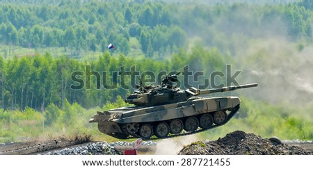 Nizhniy Tagil, Russia - July 12. 2008: Shooting tank T-80 jumps through ditch. Display of fighting opportunities of arms and military equipment of land forces. RAE exhibition - stock photo
