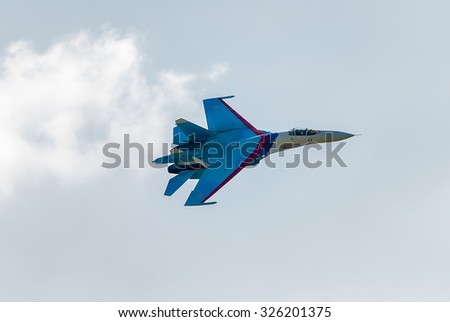 Nizhniy Tagil, Russia - July 12. 2008: Work of russian fighter SU-27 knights. Display of fighting opportunities of equipment with application of aviation. RAE exhibition - stock photo